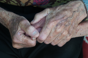 Hands of elders holding each other